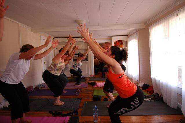 Urban Bliss Yoga Class in the middle yoga room in Cornelius, NC